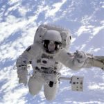 Astronaut in space with earth behind him